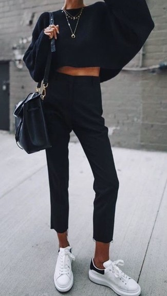 How to wear: black leather bucket bag, white leather low top sneakers, black dress pants, black knit oversized sweater