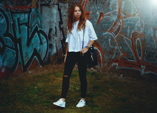 How to wear: black leather bucket bag, white low top sneakers, black ripped skinny jeans, light blue short sleeve button down shirt