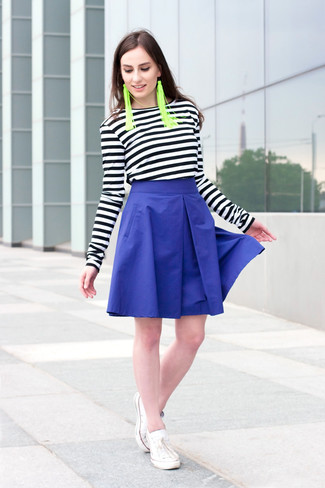 How to wear: green earrings, white low top sneakers, blue full skirt, black and white horizontal striped long sleeve t-shirt