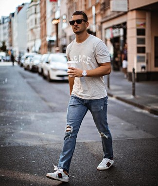 How to wear: black sunglasses, white print leather low top sneakers, blue ripped jeans, grey print crew-neck t-shirt