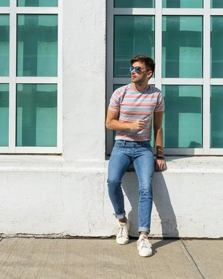How to wear: blue sunglasses, white low top sneakers, blue jeans, light blue horizontal striped crew-neck t-shirt