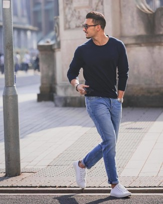 How to wear: white low top sneakers, blue jeans, navy crew-neck sweater