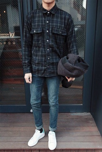 Men's Looks & Outfits: What To Wear In 2020: Try pairing a navy plaid flannel long sleeve shirt with blue jeans to put together an incredibly sharp and modern-looking casual outfit. A pair of white canvas low top sneakers finishes off this look quite well.