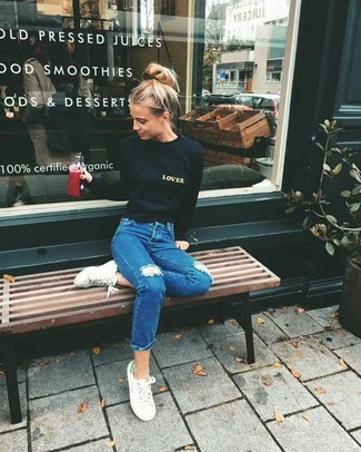 How to Wear a Black Print Crew-neck Sweater For Women: For relaxed dressing with a modernized spin, try pairing a black print crew-neck sweater with blue ripped jeans. Our favorite of a variety of ways to complete this ensemble is with a pair of white low top sneakers.