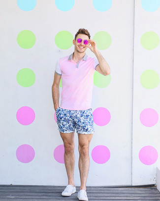 How to wear: hot pink sunglasses, white canvas low top sneakers, blue floral shorts, pink polo