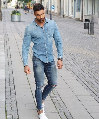 How to wear: silver watch, white low top sneakers, blue ripped skinny jeans, light blue denim shirt