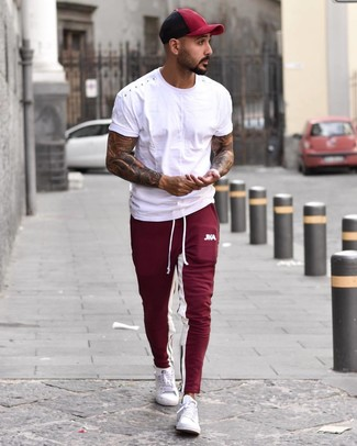 How to wear: burgundy baseball cap, white low top sneakers, burgundy sweatpants, white crew-neck t-shirt
