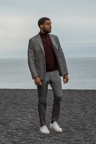 How to Wear a Grey Wool Suit: Channel your inner Bond and marry a grey wool suit with a burgundy turtleneck. Why not grab a pair of white canvas low top sneakers for an air of stylish effortlessness? This outfit is the perfect answer to the question of how to dress well into your 30s.