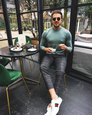 How to wear: black sunglasses, white print leather low top sneakers, charcoal check chinos, mint crew-neck sweater