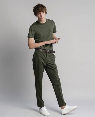 How to Wear White Leather Low Top Sneakers For Men: Consider pairing a dark green crew-neck t-shirt with dark green chinos for a casual level of dress. Complement this getup with white leather low top sneakers to pull the whole look together.