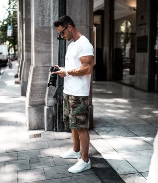 How to wear: black sunglasses, white low top sneakers, dark green camouflage shorts, white crew-neck t-shirt