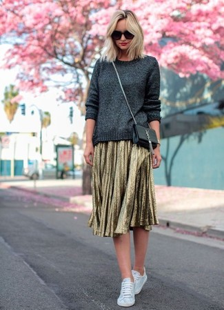 How to wear: black leather crossbody bag, white canvas low top sneakers, gold pleated midi skirt, charcoal crew-neck sweater