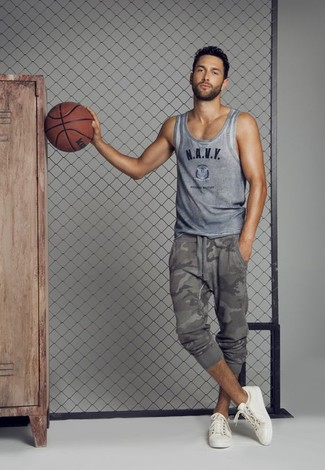 How to wear: white low top sneakers, grey camouflage sweatpants, grey print tank