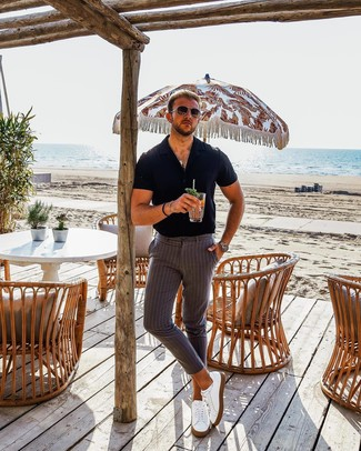 How to wear: dark brown sunglasses, white leather low top sneakers, grey vertical striped chinos, black short sleeve shirt