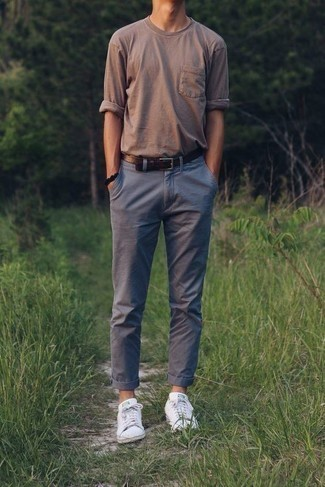 Fashion for 30 Year Old Men: What To Wear: A brown long sleeve t-shirt and grey chinos are absolute menswear must-haves if you're figuring out a casual wardrobe that holds to the highest sartorial standards. If you're wondering how to finish, complement your ensemble with white low top sneakers.