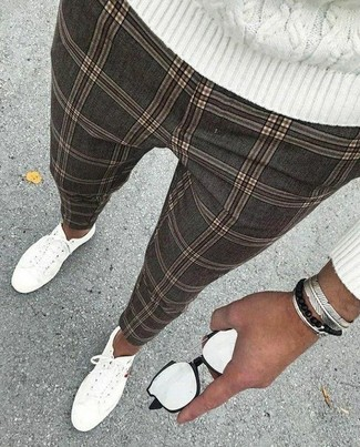 How to wear: silver bracelet, white canvas low top sneakers, grey check chinos, white cable sweater