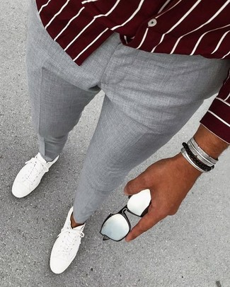How to wear: silver bracelet, white leather low top sneakers, grey dress pants, burgundy vertical striped long sleeve shirt