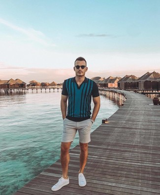 How to wear: dark brown sunglasses, white low top sneakers, grey shorts, teal vertical striped polo
