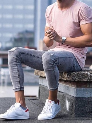 How to wear: grey leather watch, white leather low top sneakers, grey ripped skinny jeans, pink crew-neck t-shirt