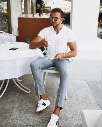 How to wear: grey sunglasses, white print leather low top sneakers, light blue chinos, white short sleeve shirt