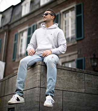How to wear: black sunglasses, white print leather low top sneakers, light blue ripped jeans, grey hoodie