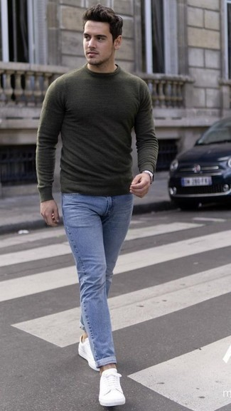 How to Wear an Olive Crew-neck Sweater For Men: This combination of an olive crew-neck sweater and light blue jeans is clean, on-trend and very easy to imitate. White leather low top sneakers are a great option to finish this ensemble.