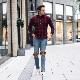 How to Wear Light Blue Ripped Jeans For Men: Hard proof that a red and navy plaid long sleeve shirt and light blue ripped jeans are amazing when worn together in an edgy outfit. Finish with white print leather low top sneakers to completely change up the outfit.