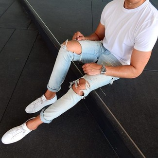 How to Wear Light Blue Ripped Jeans For Men: A white crew-neck t-shirt and light blue ripped jeans are the kind of a winning off-duty combo that you need when you have zero time to pick out an outfit. Add an elegant twist to an otherwise straightforward outfit by finishing off with white leather low top sneakers.