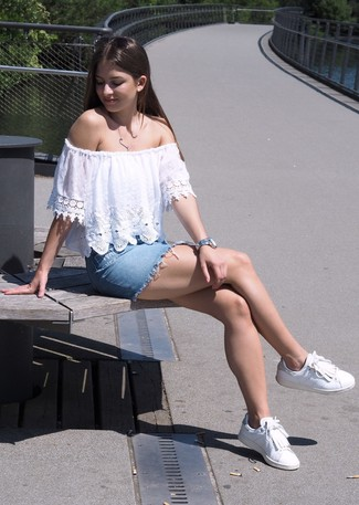 How to Wear a White and Black Lace Blouse: A white and black lace blouse and a light blue denim mini skirt make for the ultimate cool-girl's casual ensemble. If you need to immediately dress down this ensemble with a pair of shoes, why not add white fringe leather low top sneakers to the mix?