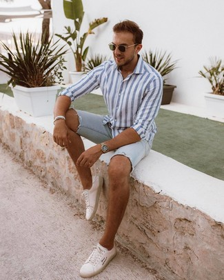 How to wear: olive sunglasses, white leather low top sneakers, light blue denim shorts, white and blue vertical striped long sleeve shirt
