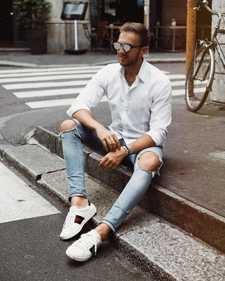 How to wear: grey sunglasses, white print leather low top sneakers, light blue ripped skinny jeans, white long sleeve shirt