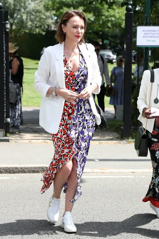 How to wear: silver watch, white low top sneakers, multi colored floral maxi dress, white blazer