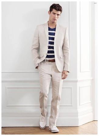 How to wear: white and black horizontal striped canvas belt, white low top sneakers, navy and white horizontal striped crew-neck t-shirt, beige suit