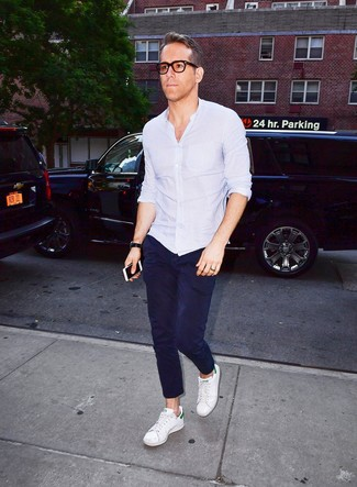 How to wear: black leather watch, white leather low top sneakers, navy chinos, light blue long sleeve shirt