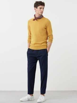 How to Wear a Mustard Crew-neck Sweater For Men: If you're in search of a casual yet stylish outfit, reach for a mustard crew-neck sweater and navy chinos. If you want to immediately tone down your look with a pair of shoes, complement your ensemble with white leather low top sneakers.