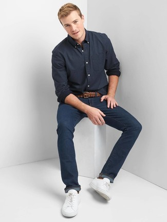 How to wear: brown woven leather belt, white leather low top sneakers, navy jeans, navy polka dot long sleeve shirt