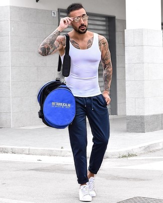 How to wear: blue duffle bag, white low top sneakers, navy sweatpants, white tank