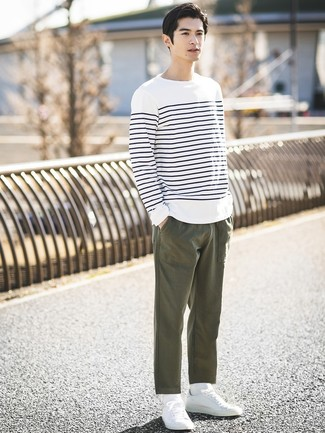 How to wear: white socks, white low top sneakers, olive chinos, white and navy horizontal striped long sleeve t-shirt