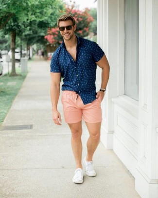 How to wear: dark brown sunglasses, white canvas low top sneakers, pink shorts, navy print short sleeve shirt