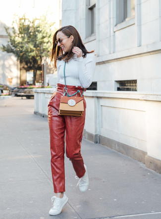 How to wear: tobacco leather crossbody bag, white leather low top sneakers, red leather tapered pants, light blue turtleneck