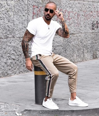 How to wear: black sunglasses, white leather low top sneakers, tan sweatpants, white crew-neck t-shirt
