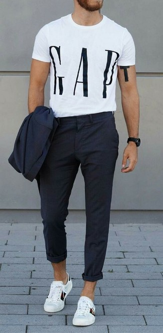 How to wear: black watch, white leather low top sneakers, white and black print crew-neck t-shirt, navy suit