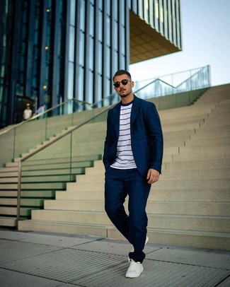 How to wear: black sunglasses, white leather low top sneakers, white and navy horizontal striped crew-neck t-shirt, navy suit