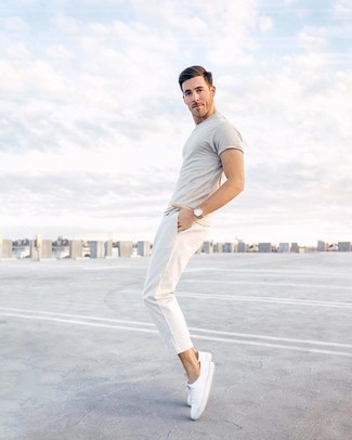 How to wear: tan leather watch, white canvas low top sneakers, white chinos, grey crew-neck t-shirt