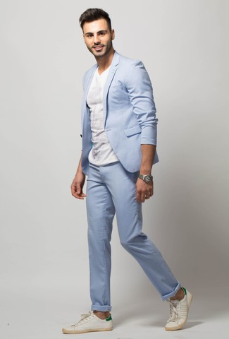 How to wear: silver watch, white leather low top sneakers, white crew-neck t-shirt, light blue suit