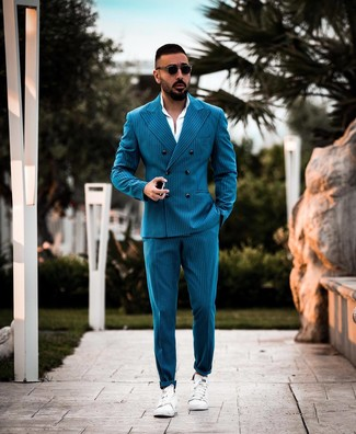 How to wear: black sunglasses, white leather low top sneakers, white dress shirt, teal vertical striped suit