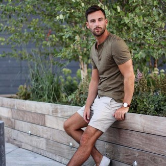 How to wear: dark brown leather watch, white canvas low top sneakers, white shorts, olive henley shirt