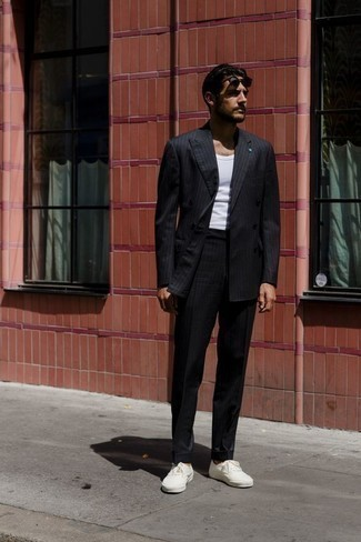 How to Wear a Black Vertical Striped Suit: For casual elegance with a rugged take, consider pairing a black vertical striped suit with a white tank. If you want to break out of the mold a little, add a pair of white canvas low top sneakers to the mix.