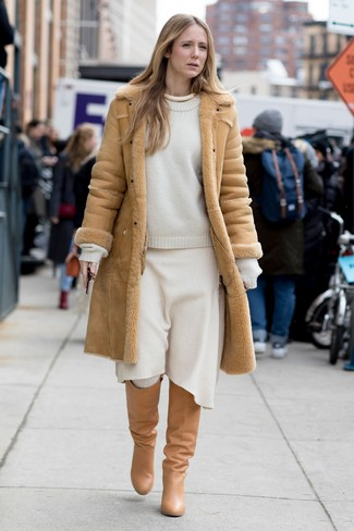How to wear: tan leather knee high boots, white wool midi skirt, white crew-neck sweater, tan shearling coat