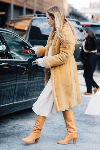 How to wear: tan leather knee high boots, white wool midi skirt, white oversized sweater, tan shearling coat